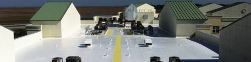 spray foam roofing system with coating